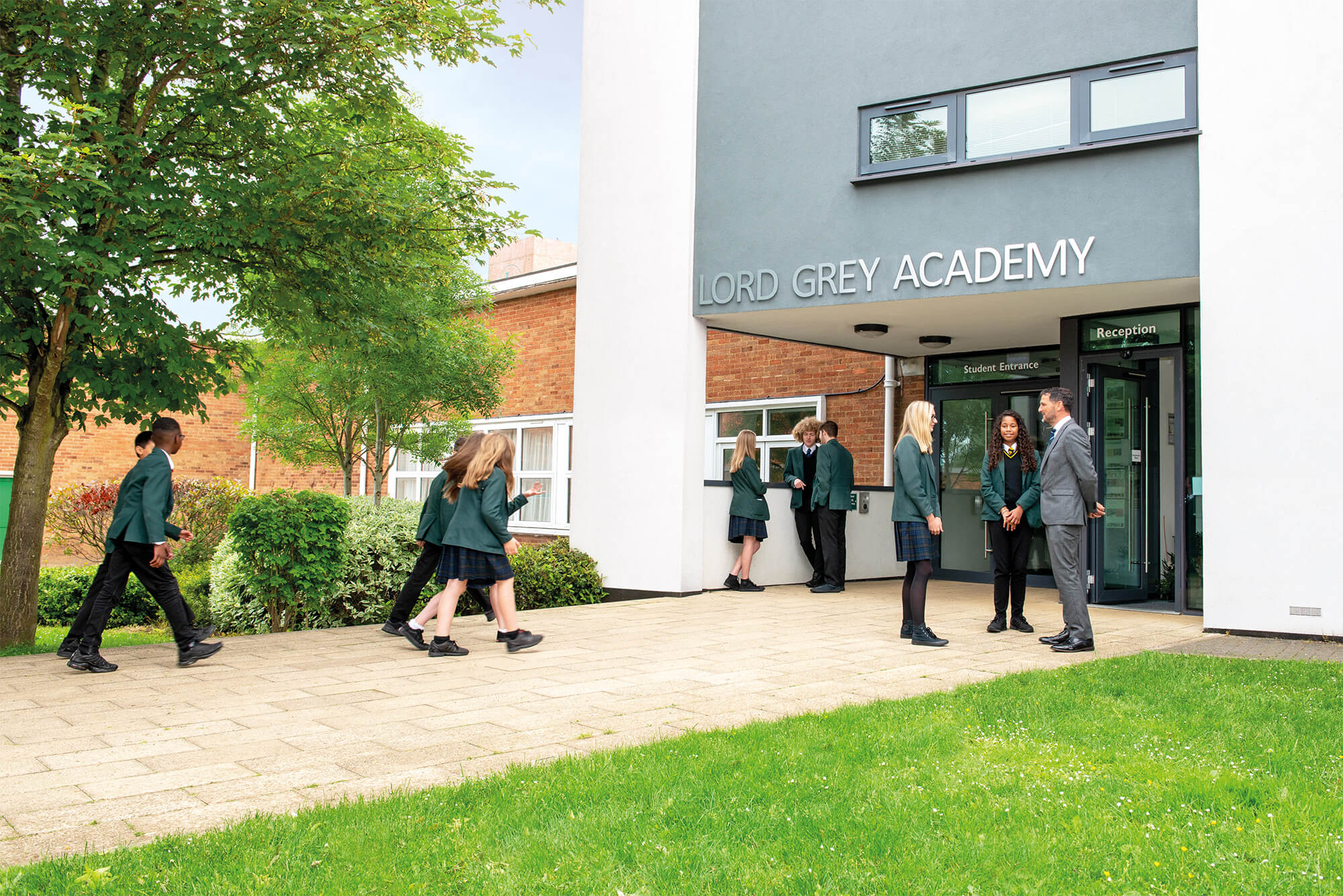 Students being greeted by the Principal at Lord Grey Academy